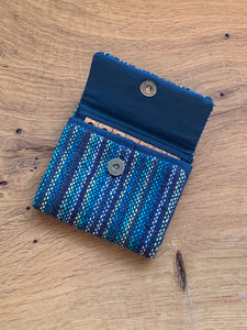 Handwoven navy blue handwoven cotton fabric sewn with wool and cork to organize your earrings and necklaces during travel.