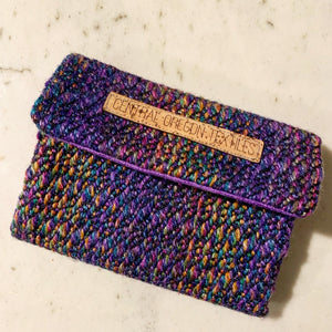 Handwoven purple handwoven yarn and black bamboo fabric sewn with wool and cork to organize your jewelry during travel. Includes a pocket to keep necklace pendents from becoming entangled and store your rings