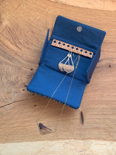 Load image into Gallery viewer, Handwoven navy blue handwoven cotton fabric sewn with wool and cork to organize your earrings and necklaces during travel.