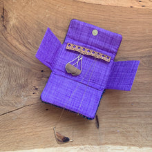Load image into Gallery viewer, Handwoven purple handwoven yarn and black bamboo fabric sewn with wool and cork to organize your jewelry during travel. Includes a pocket to keep necklace pendents from becoming entangled and store your rings