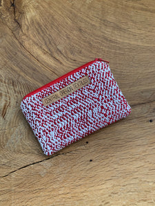 Red wool and white bamboo handwoven fabric sewn with red and grey wool into a small pouch that can be used for coins, credit cards and other smaller items