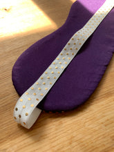 Load image into Gallery viewer, Handwoven eye mask made from purple wool and black bamboo with white and gold elastic band