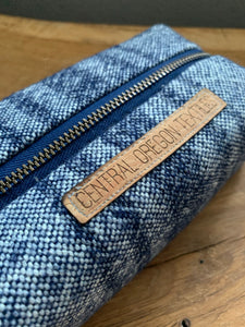 Navy blue wool striped toiltery bag with bronze zipper and leather pull tabs