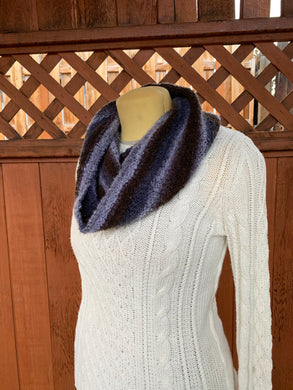 Grey and brown handwoven cowl scarf made in Bend Oregon wrapped around the neck and paired with an white sweater