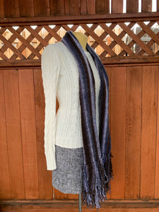 Grey and brown bamboo and synthetic handwoven scarf made in Bend Oregon draped around the neck and paired with an white sweater
