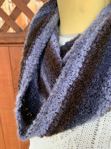 Grey and brown handwoven cowl scarf made in Bend Oregon wrapped around the neck and paired with an white sweater close-up