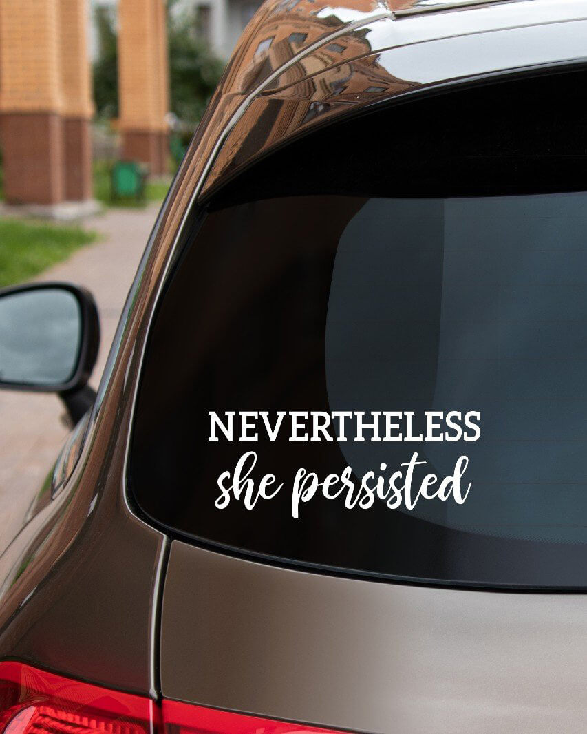 Rear car window with nevertheless she persisted Elizabeth Warren sticker