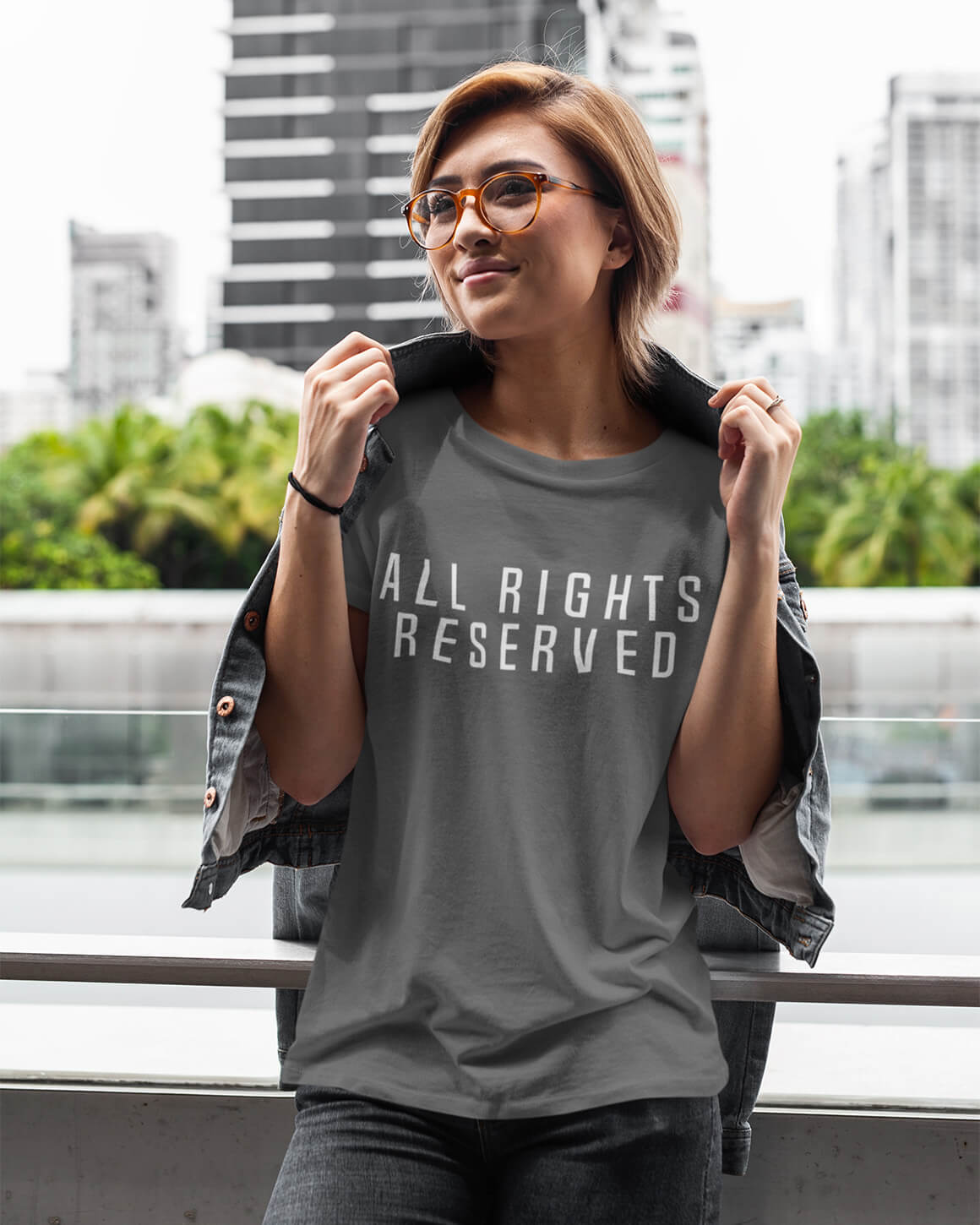 Woman wearing gray all rights reserved pro choice t shirt