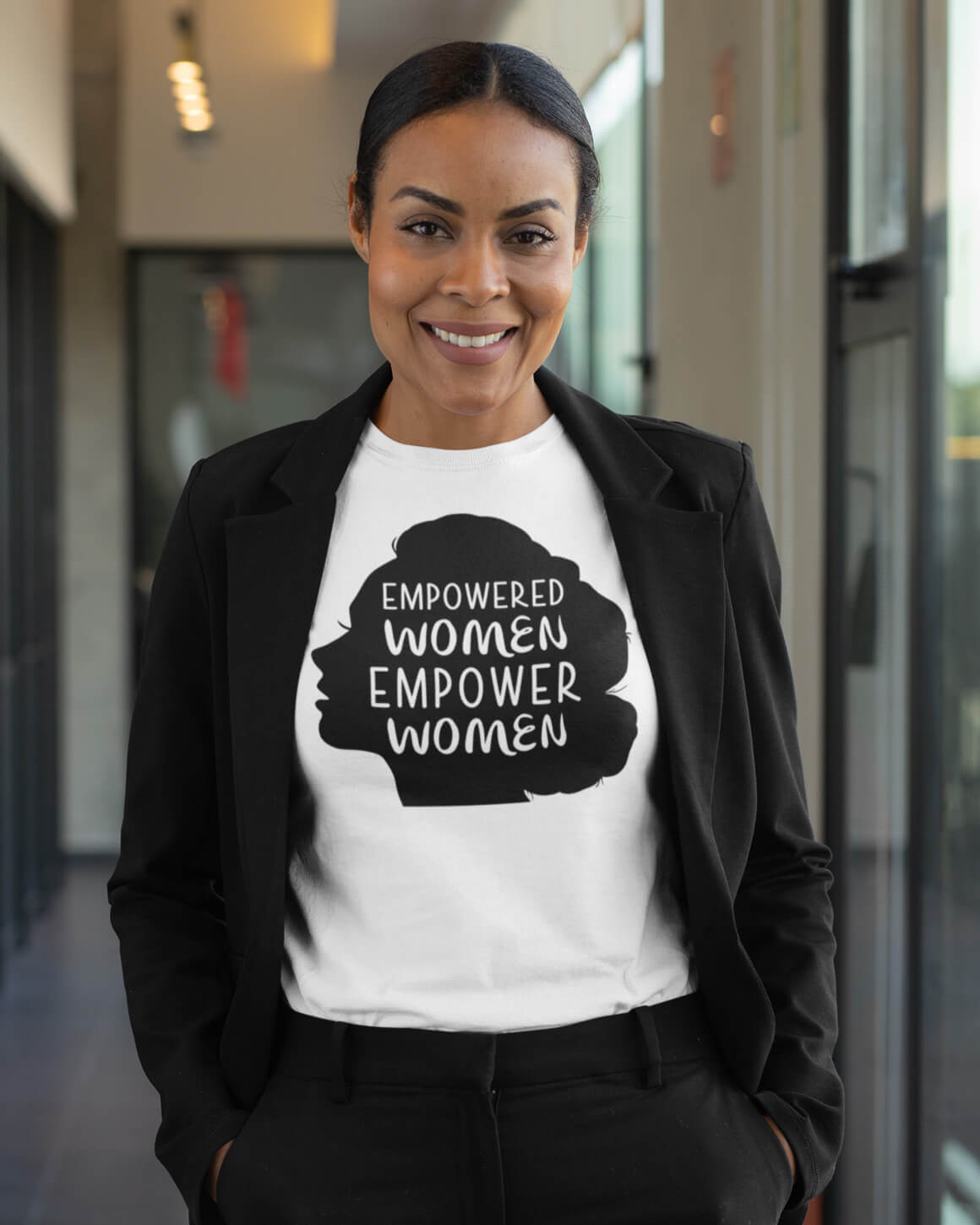 Woman wearing empowered women empower women shirt