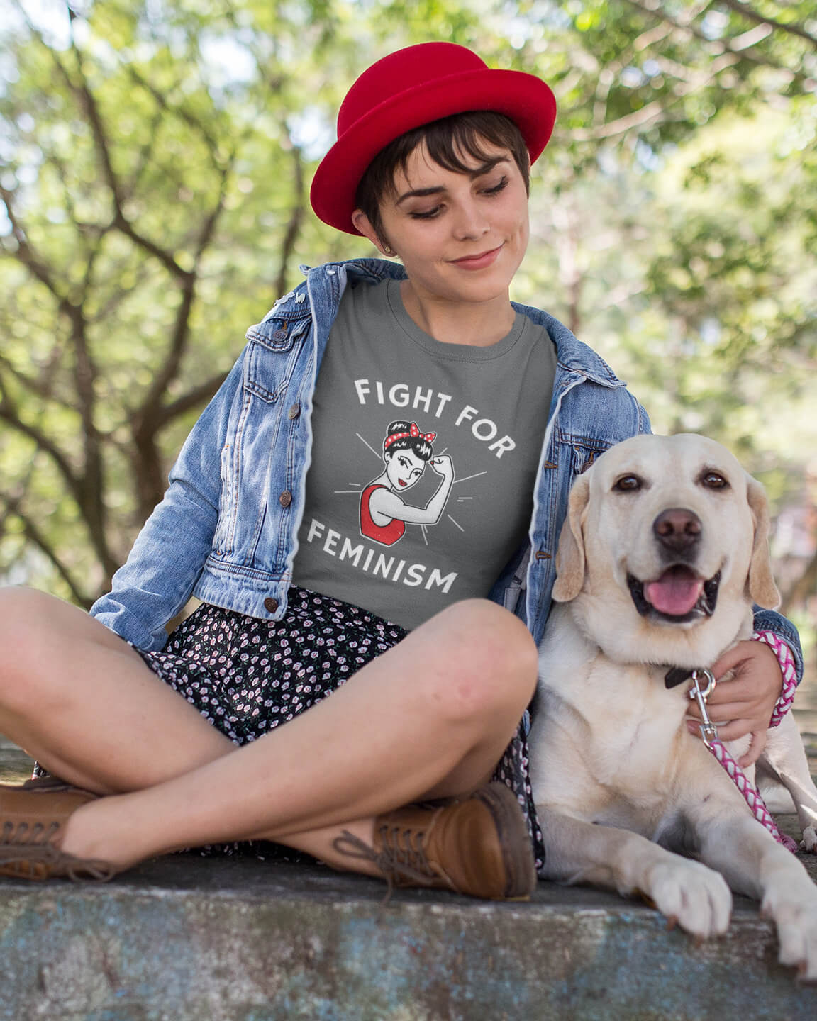 Woman petting her dog wearing Fight For Feminism shirt