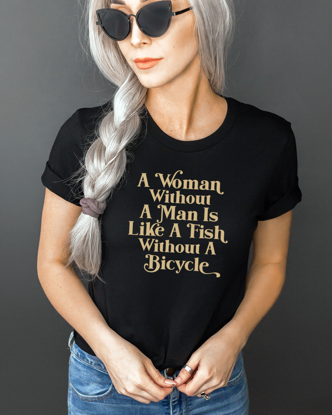 Women in black sunglasses and jeans wearing a funny feminist t-shirt