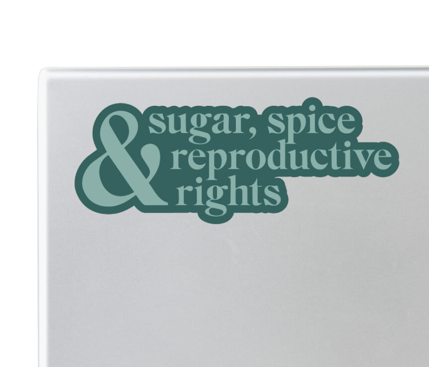 Close up of laptop with green pro choice sugar, spice and reproductive rights sticker