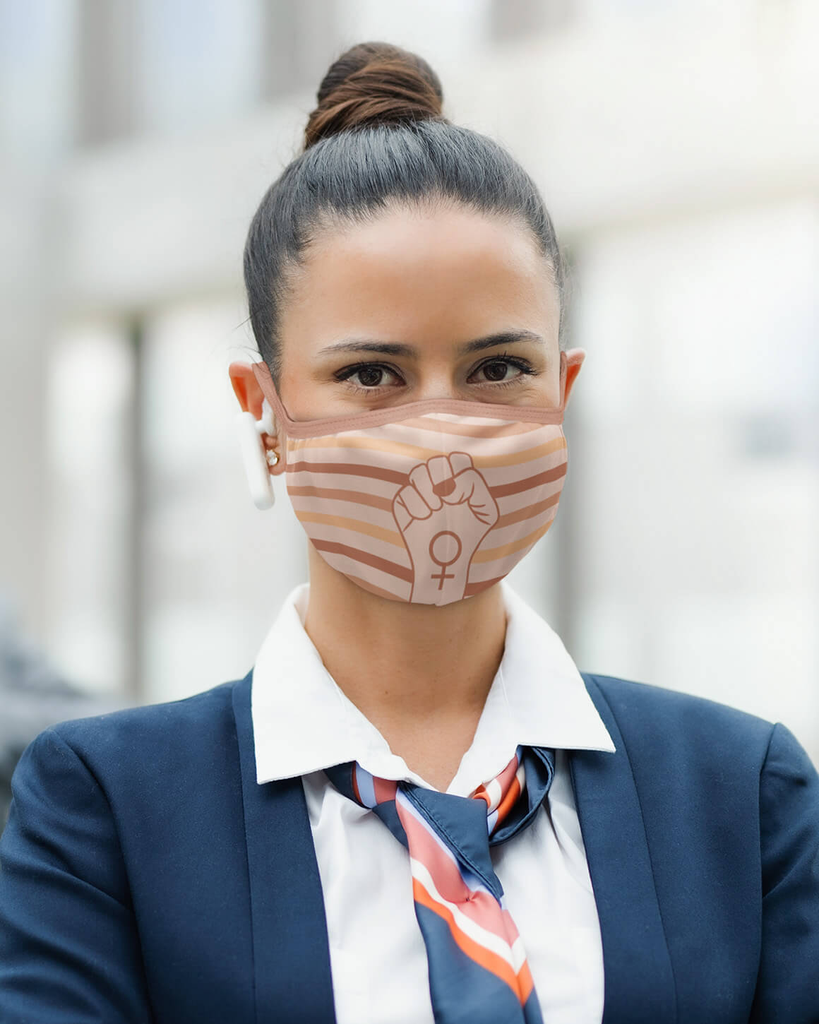 Woman in a suit wearing resist face mask