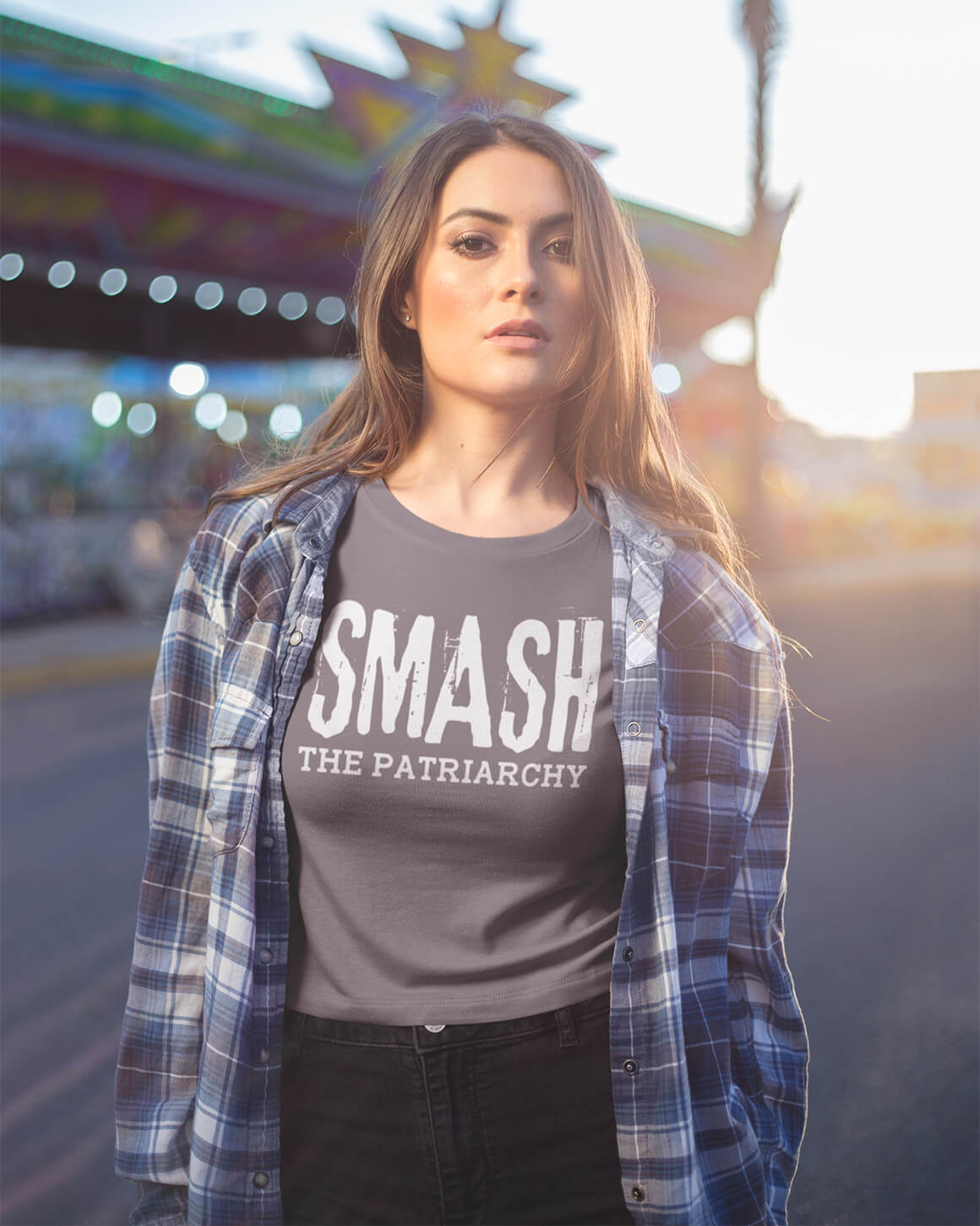 Girl wearing smash the patriarchy t shirt and flannel