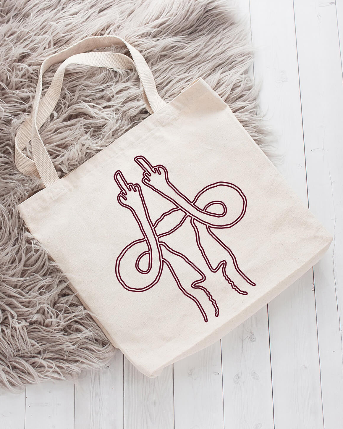 Cotton tote bag with a uterus giving the middle finger design