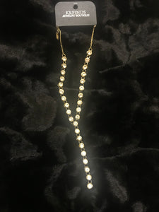 Linear jeweled necklace