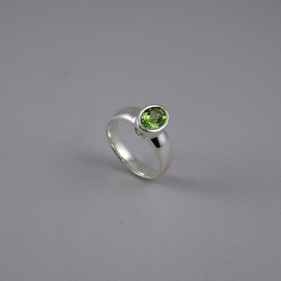 Oval Peridot Sterling Silver Ring with Horseshoe Detail