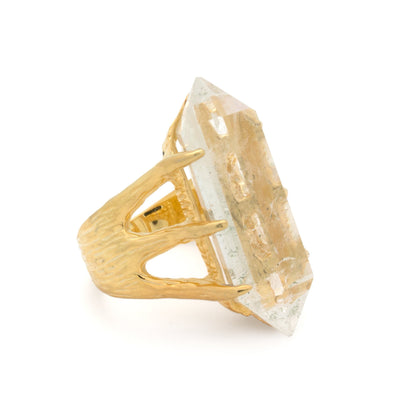 A Bohemian style statement ring featuring a quartz crystal set in 16K Gold Plated Brass, by Tribe Jewelry Designer Sarah Lewis.