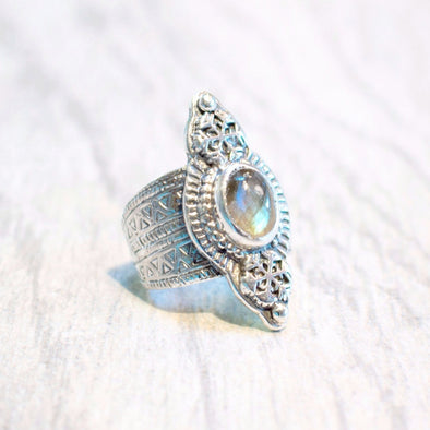 A one of kind ring featuring a faceted labradorite stone set in sterling silver, with snowflake and carved geometric design handmade by Tribe Jewelry Designer Sarah Lewis.