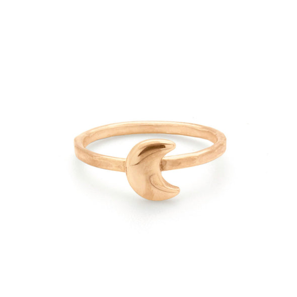 A bohemian style, gold plated stacking ring featuring a tiny crescent moon on a hammered band, by Tribe Jewelry Designer Sarah Lewis.