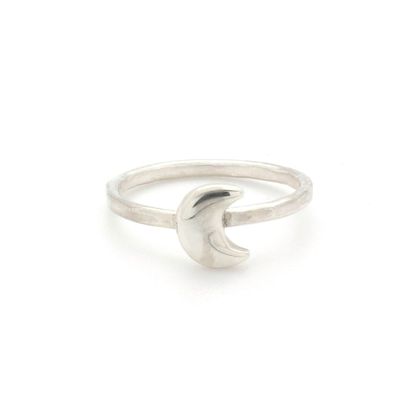 A bohemian style, silver plated stacking ring featuring a tiny crescent moon on a hammered band, by Tribe Jewelry Designer Sarah Lewis.