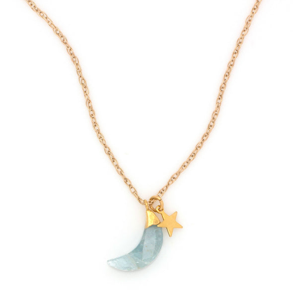 A Simple, bohemian style Necklace featuring an Aquamarine gemstone faceted to a Crescent Moon, in a gold dipped setting, which hangs with a Gold Plated Star charm, on a gold filled chain.