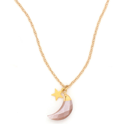 A Beautiful Bohemian style Necklace features a Moonstone faceted to a Crescent Moon, in a gold dipped setting, hanging with a Gold Plated Star charm, on a Gold Filled chain.