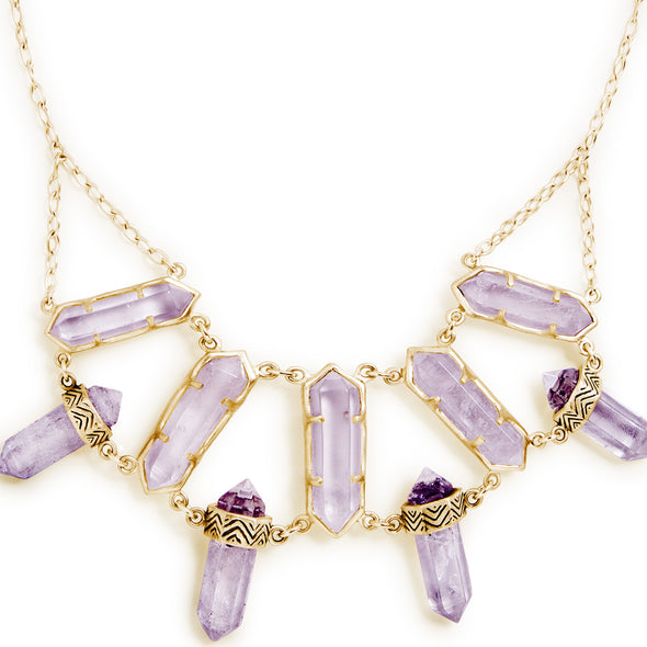 A Bohemian style, statement Bib Necklace, featuring 9 Amethyst Crystals set in Gold Plated Sterling Silver, handmade by Tribe Jewelry Designer Sarah Lewis.
