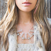 A Statement Bib Necklace, featuring 9 Quartz Crystals set in Sterling Silver, handmade by Tribe Jewelry Designer Sarah Lewis.