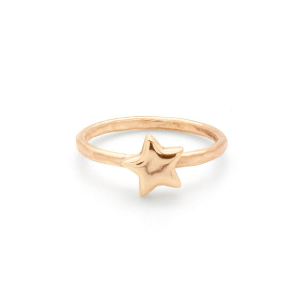 A bohemian style, gold plated stacking ring featuring a tiny star on a hammered band, by Tribe Jewelry Designer Sarah Lewis.