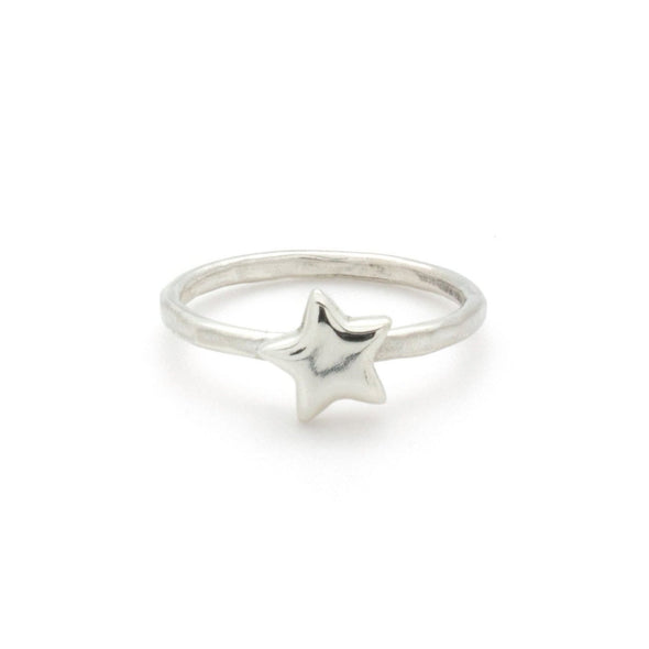 A bohemian style, silver plated stacking ring featuring a tiny star on a hammered band, by Tribe Jewelry Designer Sarah Lewis.