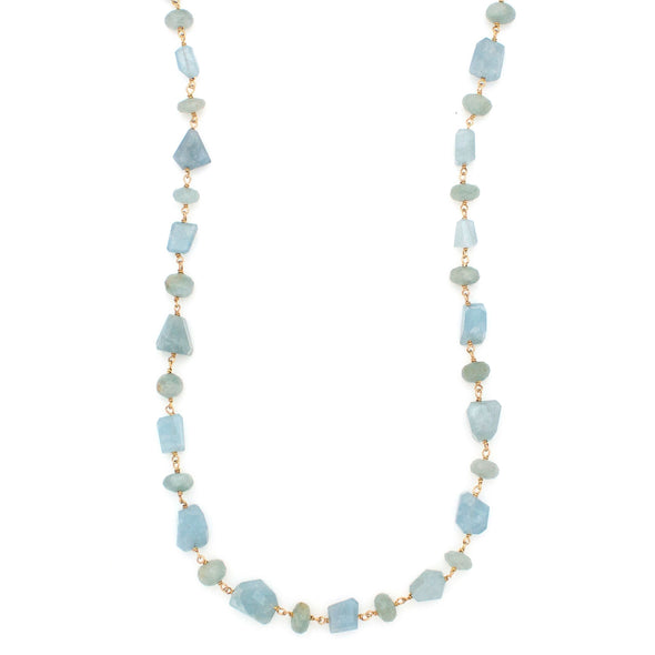 A Long Bohemian Beaded Necklace Featuring Faceted Aquamarine gemstones on a wire-wrapped chain, paired with an artisanal 18 K Gold plated chain, handmade by Tribe Jewelry Designer Sarah Lewis.