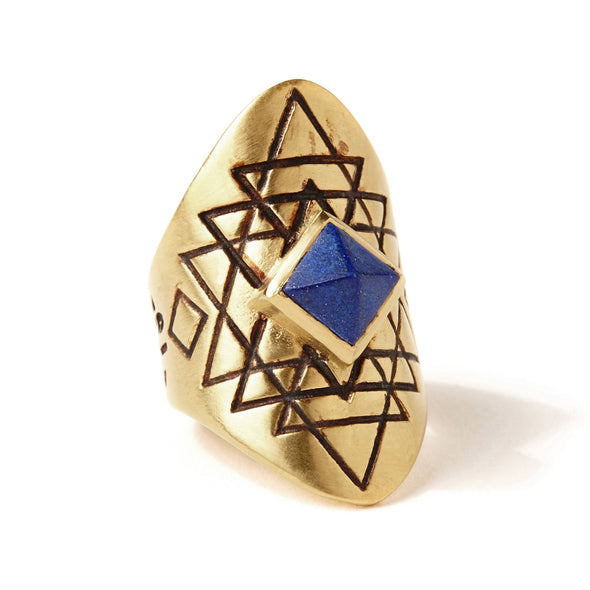 A bohemian style statement ring featuring a lapis lazuli stone pyramid set in gold plated brass, with carved geometric sri yantra design, by Tribe Jewelry Designer Sarah Lewis.
