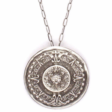 A Bohemian style Necklace featuring an antiqued silver Aztec calendar medallion hanging on a sterling silver chain, handmade by Tribe Jewelry Designer Sarah Lewis.