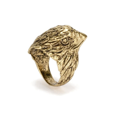 An bohemian style ring featuring an eagle design carved in antiqued gold plated brass by Tribe Jewelry Designer Sarah Lewis.
