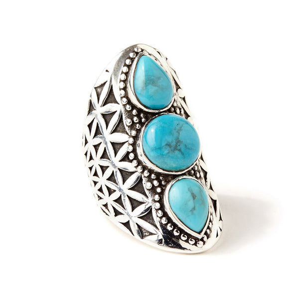 A Bohemian style statement ring featuring 3 Turquoise Cabochons set in oxidized Sterling Silver, with a carved Flower of Life pattern pattern around band, by Tribe Jewelry Designer Sarah Lewis.