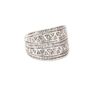 A bohemian style, oxidized Sterling Silver ring with a Carved Geometric Triangle Design, by Tribe Jewelry Designer Sarah Lewis.
