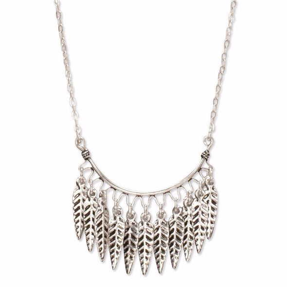 A Bohemian style Necklace features a fringe of feathers hanging on Sterling Silver chain, handmade by Tribe Jewelry Designer Sarah Lewis.