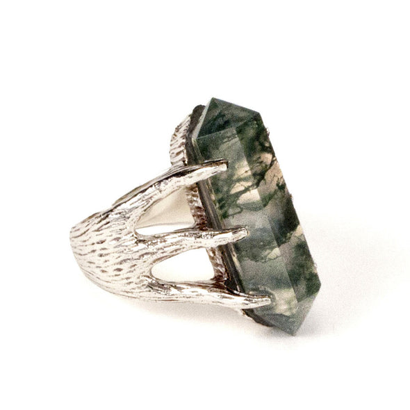 A Bohemian style statement ring featuring a moss agate quartz crystal set in Sterling Silver, by Tribe Jewelry Designer Sarah Lewis.