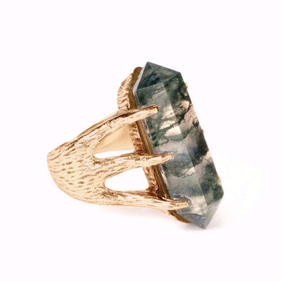 A Bohemian style statement ring featuring a moss agate crystal set in 18K gold plated sterling silver, by Tribe Jewelry Designer Sarah Lewis.