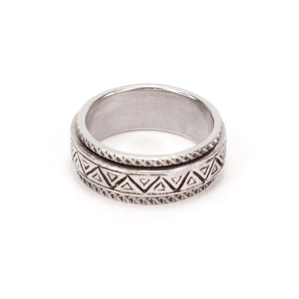Sterling silver spinner ring with carved geometric pattern, by designer Sarah Lewis.