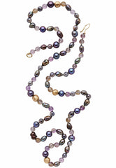 Julie Cohn Design. Pearls and gemstones in a purple palette create this sumptuous necklace. Artisan jewelry. Handcrafted in the USA.