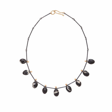 Julie Cohn Design Nero Necklace with Black Clay Eggs and Sterling Silver Links.