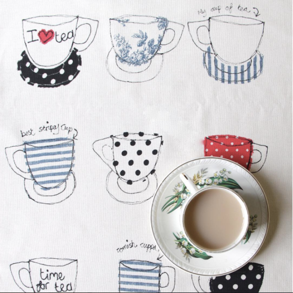 tea cups tea towel by poppy treffry