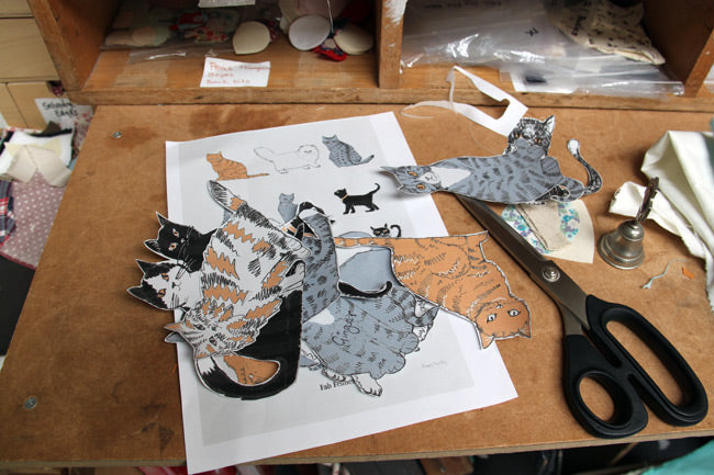 Cut out cat drawings and test layout