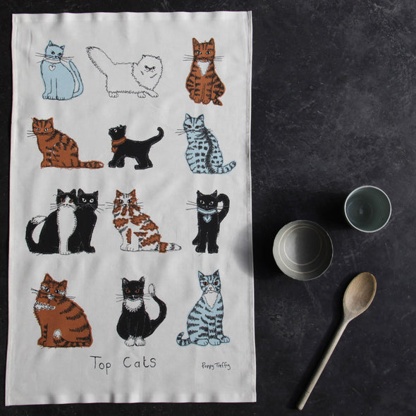 cats tea towel with cups and spoon