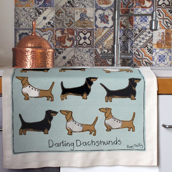 folded daxie tea towel