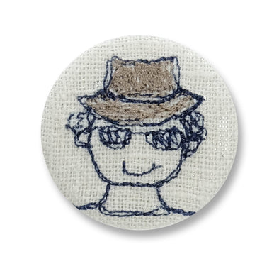 man in a hat - pretty badge