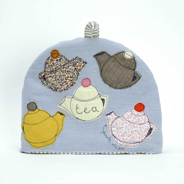 large tea cosy with tea pots