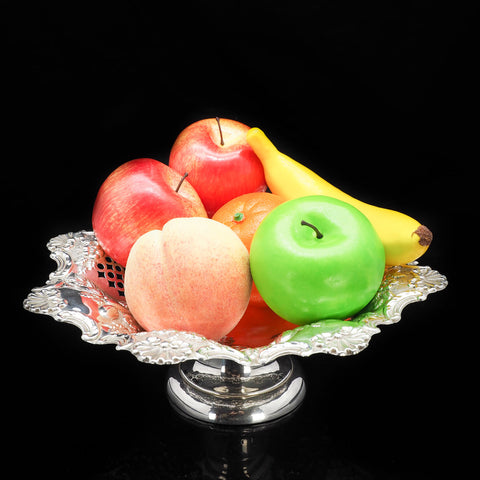 A Victorian solid silver tazza bowl with fruits on top.